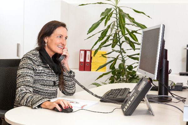 Woman calling in front of  Computer